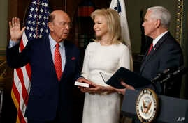 Hilary Ross, center, watches as Vice President Mike Pence swears-in new Commerce Secretary Wilbur Ross, Tuesday, Feb. 28, 2017, in the Vice President's ceremonial office in the Eisenhower Executive Office Building on the White House complex in Washin