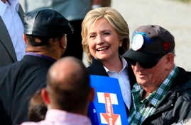 Democratic presidential candidate Hillary Rodham Clinton speaks with members of the audience, Oct. 7, 2015, during a campaign stop at the Westfair Amphitheater in Council Bluffs, Iowa.
