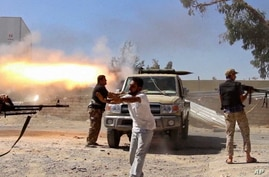 A frame grab from video obtained from a freelance journalist traveling with the Misarata brigade, fighters from the Islamist Misarata brigade fire towards Tripoli airport in an attempt to wrest control from a powerful rival militia, in Tripoli, Libya
