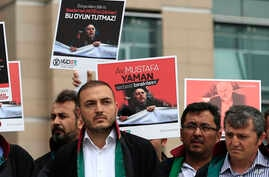 Turkish lawyers hold a protest outside Istanbul's court, July 17, 2017, demanding the release of Mustafa Yaman, a lawyer who according to Turkish media was detained earlier this month.