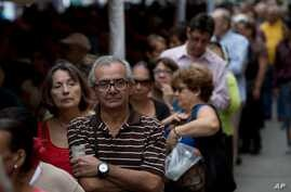 People line up to check for their signatures at data center outside of the Venezuelan National Electoral Council, CNE, headquarters, in Caracas, June 20, 2016.