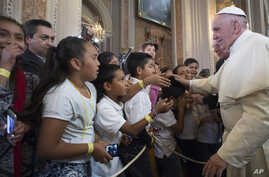 Pope Francis blesses faithful during his visit to the Morelia Cathedral in Mexico's Michoacan state, Feb. 16, 2016.