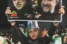 A protester holds up a poster of Iranian opposition leader Mir Hossein Mousavi (L) and reformist former president Mohammad Khatami during an anti-government rally in Tehran, 27 Dec 2009
