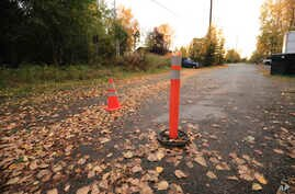 Leaves litter a street that was the scene of a 2017 attack on a Native woman in Anchorage, Alaska, by Justin Schneider, 34, who walked out of court a free man.