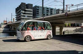 FILE - The driverless electric-free shuttle Navly drives through a district of Lyon, central France, as part of an experiment, Sept. 9, 2016.