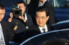Chinese President Hu Jintao arrives for the APEC summit, Vladivostok, Russia, Sept. 6, 2012.