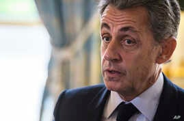 FILE - In this Nov. 6, 2017 file photo, former French President Nicolas Sarkozy attends newly named member of the Constitutional Council Dominique Lottin's oath-taking ceremony at the Elysee Palace in Paris.