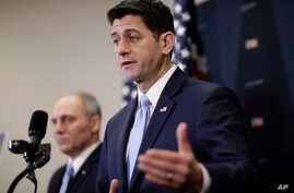 Speaker of the House Paul Ryan, R-Wis., joined at left by Majority Whip Steve Scalise, R-La., answers questions at a news conference as he defends a vote by Republicans on the House intelligence committee to release a classified memo on the Russia in...