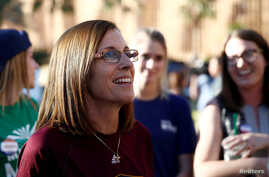FILE - Republican U.S. Senate candidate Rep. Martha McSally, center, talks with people waiting in line at the ASU Palo Verde West polling station during the U.S. midterm elections in Tempe, Arizona, U.S. Nov. 6, 2018.