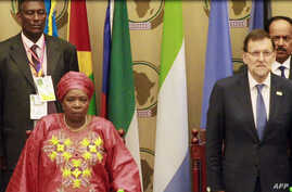 A video grab taken from AFP footage on June 26, 2014 shows African Union (AU) President Nkosazana Dlamini-Zuma and Spanish Prime Minister Mariano Rajoy attending the opening of an African Union (AU) summit in Malabo, Equatorial Guinea, on June 26, 20
