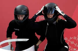 Russia's Nadezhda Sergeeva, left, and Anastasia Kocherzhova prepare to start during the women's bobsled training run at the 2018 Winter Olympics in Pyeongchang, South Korea, Feb. 18, 2018.