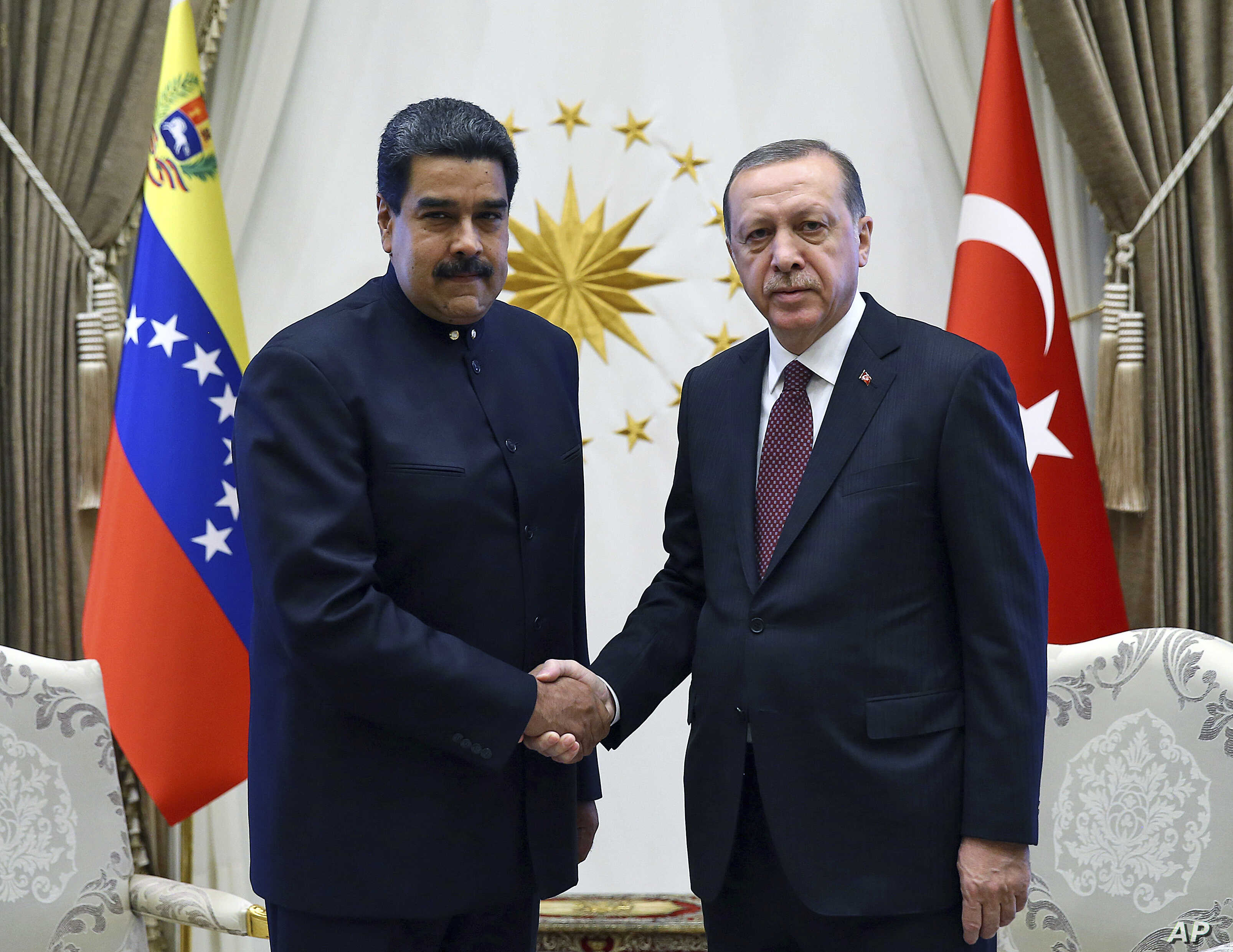 Turkey's President Recep Tayyip Erdogan, right, shakes hands with Venezuela's President Nicolas Maduro, left, prior to their meeting at the Presidential Palace in Ankara, Turkey, Oct. 6, 2017.
