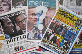 A photo taken on September 10, 2018 in Stockholm shows a selection of front pages of Swedish newspapers in Stockholm a day after the general elections.