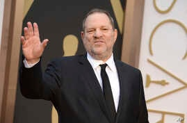 FILE - Harvey Weinstein arrives at the Oscars in Los Angeles, California, March 2, 2014. Weinstein has been fired from The Weinstein Co., effective immediately, following new information revealed regarding his conduct, the company's board of director