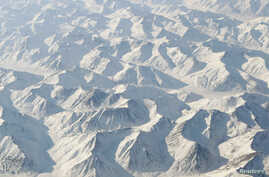 FILE - The Brooks Range spreads out to the horizon in northern Alaska, March 17, 2011.