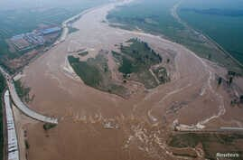 An aerial view shows that roads and fields are flooded in Xingtai, Hebei Province, China, July 21, 2016.