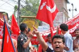 Maoist supporter en route for a mass rally in central Kathmandu, 01 May 2010