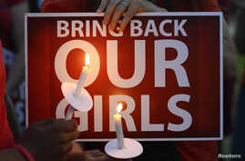 """People participate in a """"Bring Back Our Girls"""" campaign demonstration and candlelight vigil, held on Mother's Day in Los Angeles, May 11, 2014."""