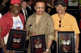 FILE - From left, Philip Bailey, Maurice White and Ralph Johnson of Earth Wind & Fire are inducted at the Hollywood Rock Walk in Los Angeles, July 7, 2003. White died at home in Los Angeles Feb. 3, 2016.