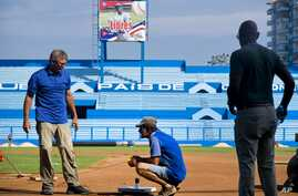 Murray Cook, left, and Phil Bradley, right, from the Major League Baseball Players Association talk to a worker during the refurbishing of the Latinoamericano stadium, March 16, 2016. The Tampa Bay Rays will play the Cuban national team March 22 in H