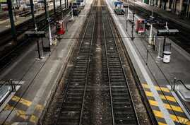 FILE - This file photo taken on June 01, 2016, deserted platforms are pictured at the Lyon Perrache railway station, during a strike of employees of French state-owned rail operator SNCF, protesting against government labor reforms.