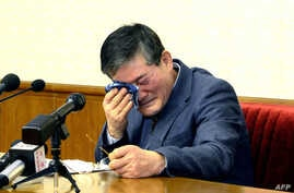 This picture released from North Korea's official Korean Central News Agency (KCNA) shows Kim Dong-Chul, a Korean-American as he addresses a news conference in Pyongyang, March 25, 2016. A Korean-American detained in North Korea admitted to attemptin