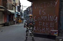 An Indian paramilitary soldier stands guard during curfew in Srinagar, Indian controlled Kashmir, Sept. 13, 2016.