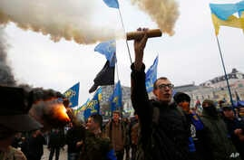 Members of the nationalist movement Svoboda (Freedom) hold flares during a rally marking the 74th anniversary of the Ukrainian Insurgent Army in Kyiv, Ukraine, Oct. 14, 2016. Ukraine celebrates Defenders Day yearly.