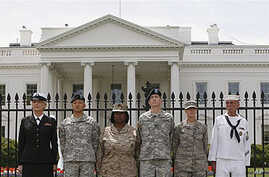Service members stand together after they handcuffed themselves to the fence outside the White House in Washington during a protest for gay rights, 16 April 2010 (file photo)