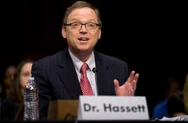 FILE - Kevin Hassett, pictured in December 2012 as he testified on economic policy on Capitol Hill in Washington, will become President Donald Trump's Council of Economic Advisers chairman.