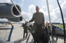Joint Chiefs Chairman General Joe Dunford boards a C-17 military aircraft for the flight from Belgium to the United States, May 19, 2016. (DOD News)