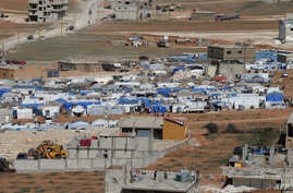 FILE - Tents house Syrian refugees in the city of Arsal in Lebanon's Bekaa valley, near the border with Syria.