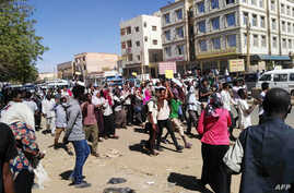 Sudanese demonstrators gather in Khartoum's twin city Omdurman, Jan. 20, 2019, where Sudanese police fired tear gas at protesters ahead of a planned march on parliament.