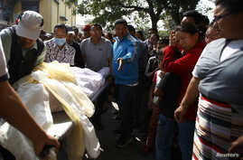 Relatives cry as the body of one of the Nepali mountaineering guides who was killed in Friday's avalanche on Mount Everest, is brought to Sherpa Monastery in Kathmandu, April 19, 2014.