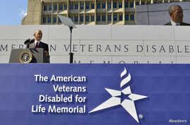U.S. President Barack Obama makes remarks at the dedication of the American Veterans Disabled for Life Memorial, near the U.S. Capitol, in Washington, October 5, 2014.