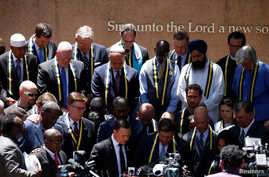 Interfaith leaders take part in a prayer vigil in a park following the multiple police shooting in Dallas, Texas, July 8, 2016.