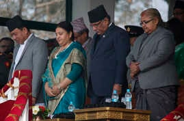 FILE - Chief Justice of the Supreme Court Sushila Karki (left) at a Democracy Day observance with Nepalese Prime Minister Pushpa Kamal Dahal, Nepalese President Bidhya Devi Bhandari and Vice President Nanda Kishor Pun, in Kathmandu, Nepal, Feb. 18, 2