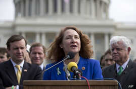 FILE - U.S. Representative Elizabeth Esty, D-Conn., center, speaks during a news conference on Capitol Hill in Washington, March 12, 2013. Esty's fellow Democrats are urging her to resign over accusation of workplace misconduct in her office.