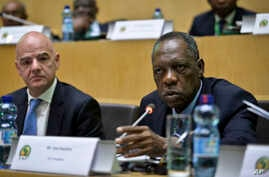 Issa Hayatou, right, speaks as FIFA President Gianni Infantino, left, listens, at the opening of the general assembly of the Confederation of African Football (CAF) in Addis Ababa, Ethiopia, March 16, 2017.