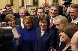 U.S. Senators' Susan Collins (R-ME) addresses reporters with fellow Senators' Jeanne Shaheen (D-NH), Tim Kaine (D-VA), Heidi Heitkamp (D-ND), Joe Manchin (D-WV), Lindsey Graham (R-SC), Amy Klobuchar (D-MN) and Jeff Flake (R-AZ) after lawmakers struck...