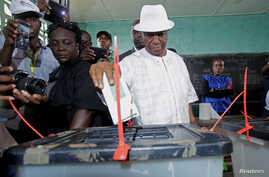 Joseph Nyuma Boakai, Liberia's vice president and presidential candidate of Unity Party (UP), votes at a polling station in Monrovia, Liberia