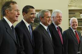 President George W. Bush (center) poses with President-elect Barack Obama, and former presidents, from left, George H.W. Bush, left, Bill Clinton and Jimmy Carter, Jan. 7, 2009, in the Oval Office of the White House in Washington.