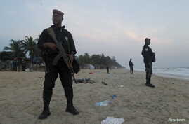 Soldiers stand in guard on the beach in Grand Bassam, Ivory Coast, after a terrorist attack on a resort there March 13, 2016.