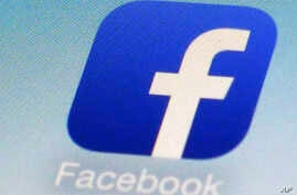 FILE - This Feb. 19, 2014, photo shows a Facebook app icon on a smartphone in New York.