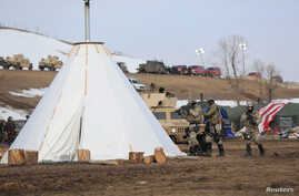 The U.S. National Guard attempt to clear the Oceti Sakowin camp near Cannon Ball, North Dakota, Feb. 23, 2017.