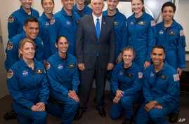 Vice President Mike Pence poses for a photograph with NASA's 12 new astronauts, June 7, 2017, at NASA's Johnson Space Center in Houston, Texas. They are, clockwise from top left, Robb Kulin, Jonny Kim, Bob Hines, Warren Hoburg, Matthew Dominick, Kayl
