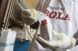 Blood samples from patients suspected of having the Ebola virus are prepared for transportation to Freetown for testing, at the Port Loko District Hospital, Sept. 27, 2014.
