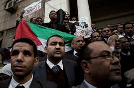 Lawyers hold a Palestinian flag during a protest after a recent U.S. decision to recognize Jerusalem as the capital of Israel, at the Lawyers Syndicate in Cairo, Egypt, Sunday, Dec. 10, 2017.