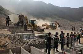Peruvian authorities demolish a Shining Path mausoleum in a cemetery on the outskirts of Lima, Peru, Dec. 29, 2018.
