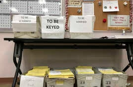 FILE - Ballots await further processing at the Franklin County Board of Elections in Columbus, Ohio, Dec. 14, 2017. The Supreme Court's decision upholding Ohio's method of removing people from voter rolls appears unlikely to have a ripple effect. Ohi